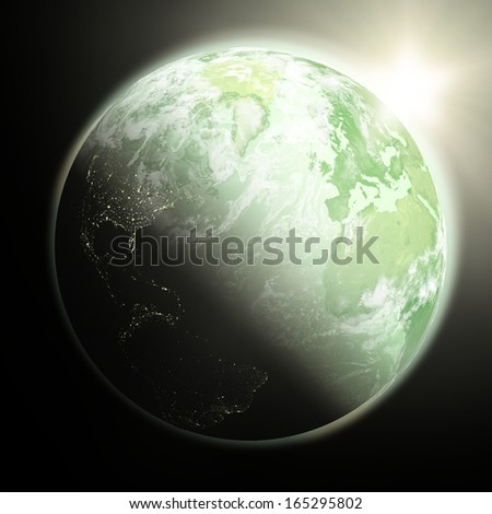 Space view of the sun rising over northern hemisphere on green planet Earth. Elements of this image furnished by NASA.