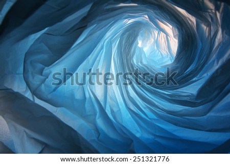 Space warp - Abstract background of the insides of a blue plastic bag with different color shades - stock photo