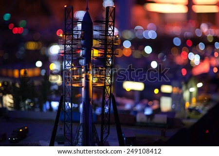 spaceship at start on space launch facility night lights background - stock photo