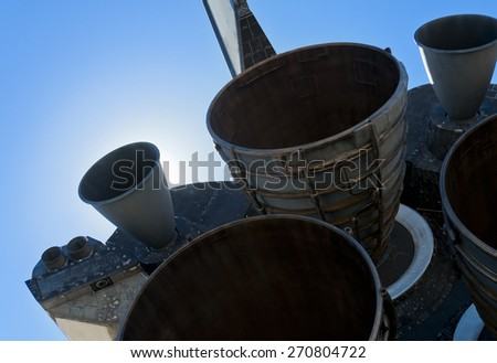 spaceship main engine thrusters against a clear blue sky - stock photo