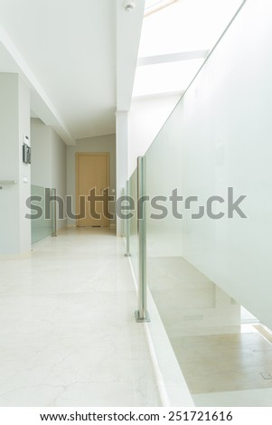 Spacious and white hall in luxury apartment - stock photo