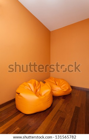 Spacious apartment - Empty room with two comfortable armchairs - stock photo