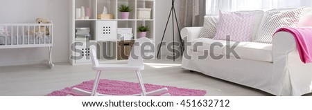 Spacious baby room in white and pink with simple furniture in new style - stock photo