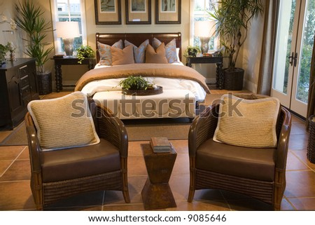 Spacious bedroom and lounge area. - stock photo