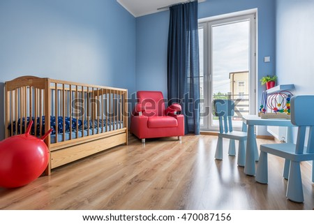 Spacious blue baby room with cot  armchair  balcony  window curtain  small  table. Baby Room Stock Images  Royalty Free Images   Vectors   Shutterstock