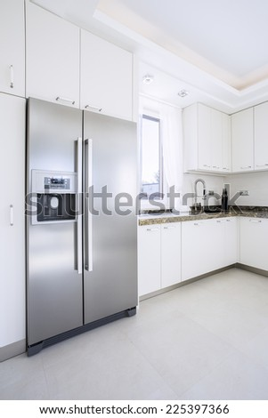 Spacious bright beauty kitchen with big fridge - stock photo