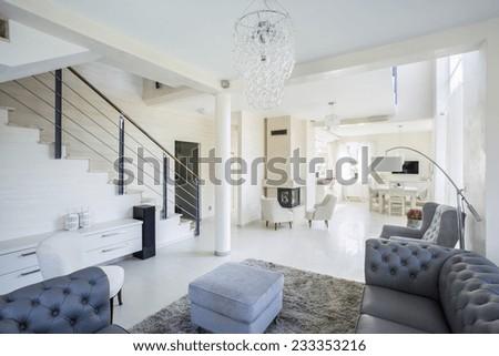Spacious, bright interior of modern family house - stock photo