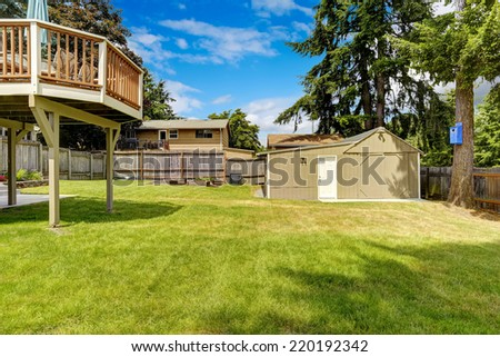 Spacious fenced backyard with shed