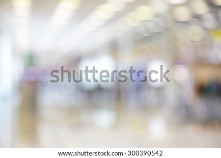 Spacious hall with duty free shops in airport out of focus - defocused blurred background - stock photo