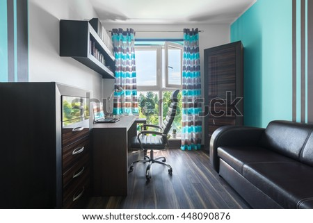 Spacious home office with brown furniture, leather sofa, armchair, window and decorative curtains