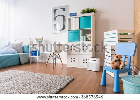 Spacious interior for child with flooring, carpet and new furniture - stock photo