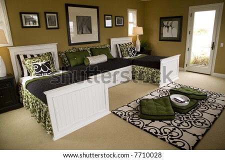 Spacious kids bedroom with play area. - stock photo