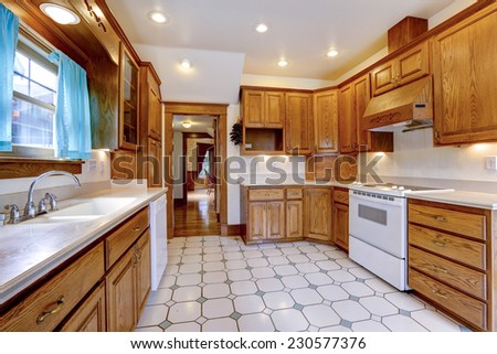 Spacious Kitchen Room Interior With Maple Cabinets And White Appliances
