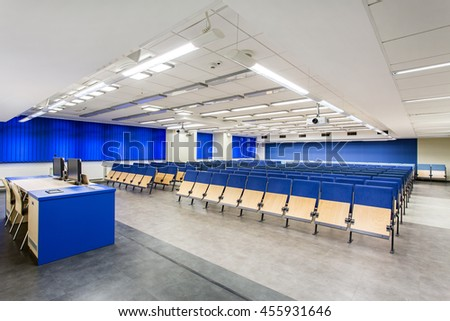 Spacious lecture hall with the seats for students with blue accents