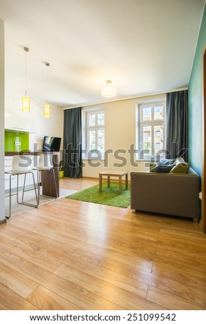 Spacious living room in modern hotel apartment - stock photo