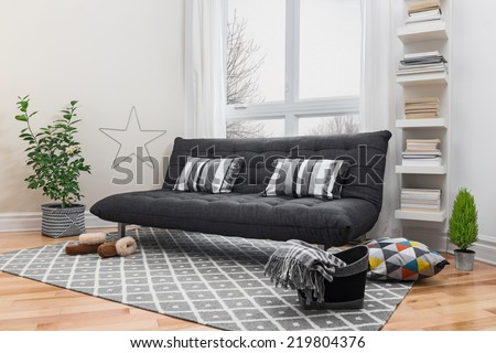 Spacious living room with gray sofa and modern decor. - stock photo