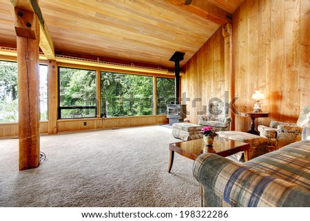 Spacious Log Cabin Living Room With High Vaulted Ceiling And Carpet Floor View Of Antique