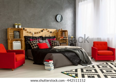 Spacious New Bedroom Decorated With Style Cozy Double Bed With Wooden Headboard Red Armchairs And
