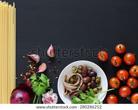 Spaghetti alla Puttanesca. Space for Text. - stock photo