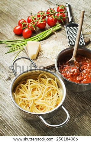 Spaghetti and bolognese sauce with parmesan cheese - stock photo