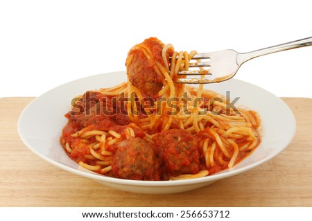Spaghetti and meatballs in a bowl with a fork - stock photo