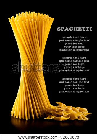 spaghetti and tomato isolated on black background - stock photo