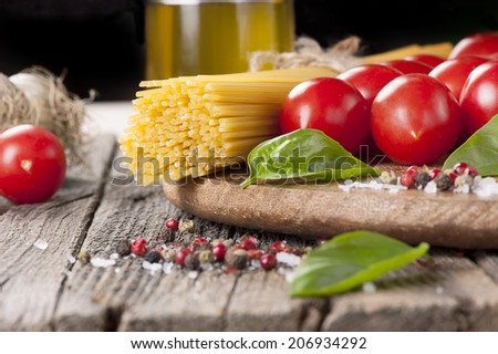Spaghetti and tomatoes with basil and garlic - stock photo