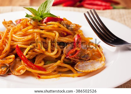spaghetti baby clams with spicy chili sauce,thai food - stock photo