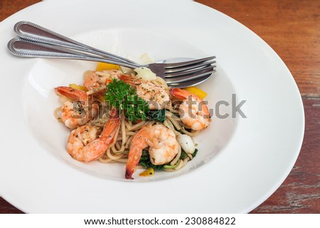 Spaghetti basil sauce with boiled shrimp in white plate