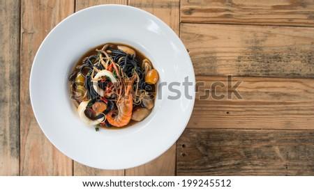 Spaghetti black ink spicy seafood - stock photo