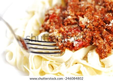 Spaghetti bolognese and fork, italian cuisine concept - stock photo