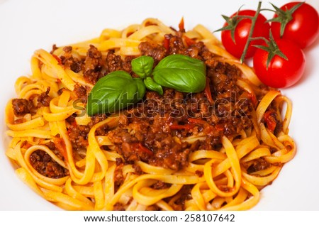 spaghetti bolognese on white plate - stock photo