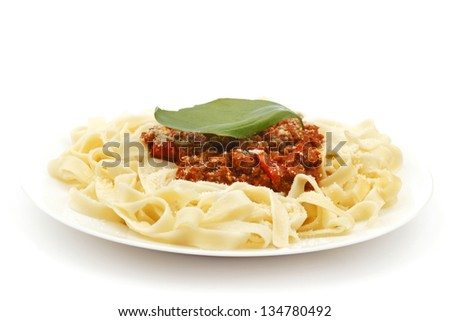 Spaghetti bolognese on white plate close-up - stock photo