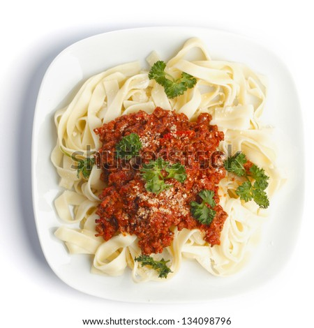 Spaghetti bolognese on white plate top view - stock photo