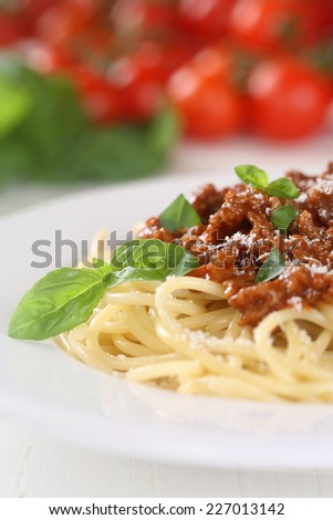 Spaghetti Bolognese or Bolognaise noodles pasta meal on a plate with basil - stock photo