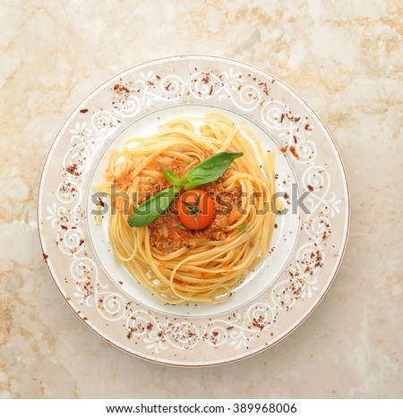 spaghetti Bolognese spaghetti, minced beef, spinach cherry tomato - an Italian dish. top view - stock photo