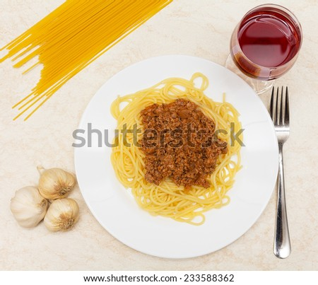 Spaghetti bolognese with red wine - stock photo