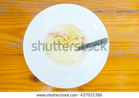 Spaghetti Bolognese with white cream sauce and ham - stock photo