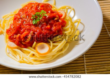 Spaghetti decorated with coriander leaf