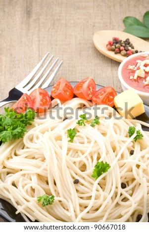 spaghetti food and vegetables spices on wood table