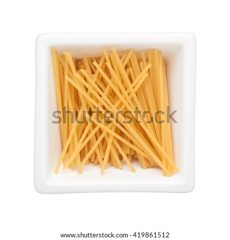 Spaghetti in a square bowl isolated on white background - stock photo