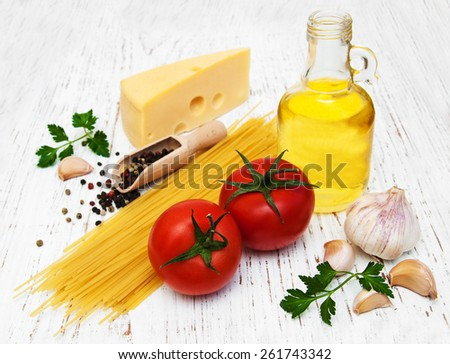 spaghetti ingredients on a old wooden background - stock photo