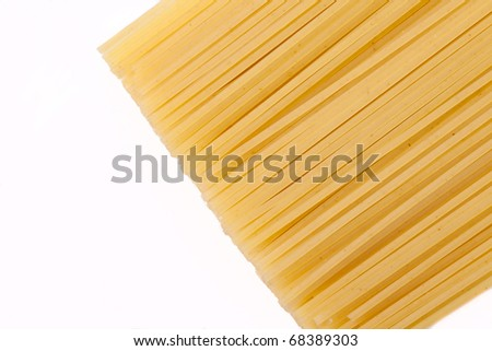 Spaghetti lie on a white background on the right side of the frame, the frame is horizontal - stock photo