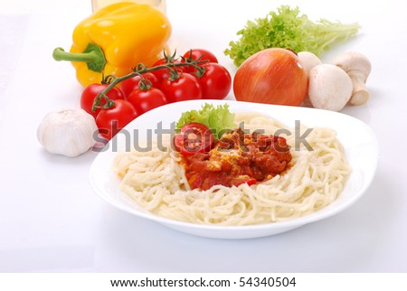 Spaghetti on white background with various vegetables - stock photo