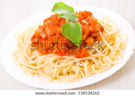 Spaghetti on white plate - stock photo