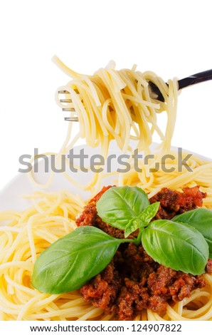 Spaghetti on white plate isolated - stock photo