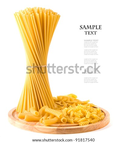 spaghetti on wooden board isolated on white background - stock photo