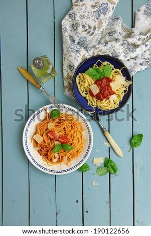 spaghetti pasta with tomato sauce and parmesan cheese and top view - stock photo