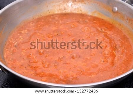 Spaghetti sauce in the wok - stock photo