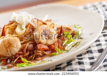 Spaghetti with bacon, scallop and dried chilli, Italian food in Japanese style - stock photo
